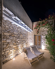 Exterior close up view of guest house terrace at night, Villa Elxis in Paros Island Greece by Studio 265 / Vazaios Petropoulos - ARC100916