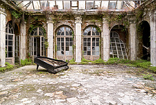a piano on the floor in a room in an abandoned palace in Poland - ARC101293