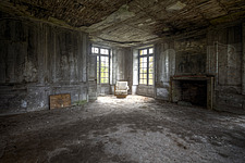 a chair in the corner of a room in an abandoned Castle in France - ARC101311