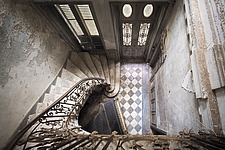 a staircase with a piano in an abandoned castle in France - ARC101318