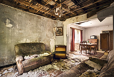 a sofa in an abandoned room of a house in Belgium - ARC101328