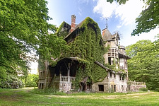 the exterior of an abandoned house that looks like it comes right out of a fairytale - ARC101394