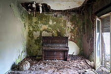 An abandoned piano in a small room of a villa in Germany - ARC102842