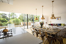Kitchen diner in Ashbrook House, a contemporary family eco-house in Blewbury, South Oxfordshire, UK - ARC102991