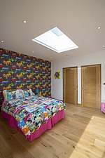 A bedroom in Ashbrook House, a contemporary family eco-house in Blewbury, South Oxfordshire, UK - ARC102997