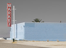 A colourful solitary roadside market building and sign stands out in the desert sun, Los Angeles, California, USA - ARC103054