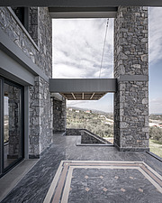 Exterior view of terrace, Olive ##38; Stone aka Katsimpiri residence in Panorama Achaea, Greece by architect Nikos Mourikis - ARC103486
