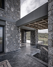 Exterior view of terrace, Olive ##38; Stone aka Katsimpiri residence in Panorama Achaea, Greece by architect Nikos Mourikis - ARC103488