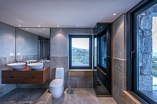 Interior view of Olive ##38; Stone aka Katsimpiri residence in Panorama Achaea Greece by architect Nikos Mourikis, master bathroom - ARC103502