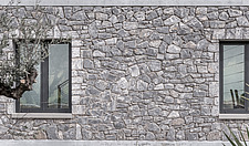 Exterior view of Olive ##38; Stone aka Katsimpiri residence in Panorama Achaea Greece by architect Nikos Mourikis, detail of masonry wall facade - ARC103506