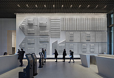 Interior view of lobby, featuring Rachel Whiteread's relief of a standard US house in the 1950s, in The American Embassy in Nine Elms, London, UK - ARC104030