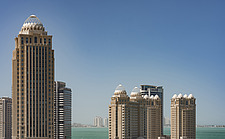 Ooredoo Tower, Qatar Telecom Headquarters in the foreground and Doha bay and skyline in the background - ARC104125