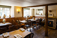 The dining room at The Village Pub, a pub and boutique hotel in Barnsley, Oxfordshire, UK - ARC104361