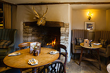 The snug at The Village Pub, a pub and boutique hotel in Barnsley, Oxfordshire, UK - ARC104362