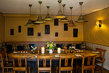 The dining room at The Village Pub, a pub and boutique hotel in Barnsley, Oxfordshire, UK - ARC104363