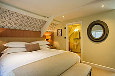 Bedroom at The Village Pub, a pub and boutique hotel in Barnsley, Oxfordshire, UK - ARC104365