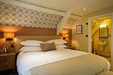 Bedroom at The Village Pub, a pub and boutique hotel in Barnsley, Oxfordshire, UK - ARC104366