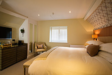 Bedroom at The Village Pub, a pub and boutique hotel in Barnsley, Oxfordshire, UK - ARC104368