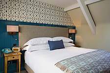 Bedroom at The Village Pub, a pub and boutique hotel in Barnsley, Oxfordshire, UK - ARC104369