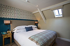 Bedroom at The Village Pub, a pub and boutique hotel in Barnsley, Oxfordshire, UK - ARC104371