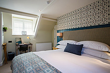 Bedroom at The Village Pub, a pub and boutique hotel in Barnsley, Oxfordshire, UK - ARC104372