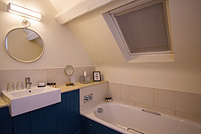 Bathroom in hotel room at The Village Pub, a pub and boutique hotel in Barnsley, Oxfordshire, UK - ARC104373