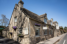 The exterior of The Village Pub, a pub and boutique hotel in Barnsley, Oxfordshire, UK - ARC104375