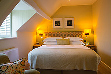 Bedroom at The Village Pub, a pub and boutique hotel in Barnsley, Oxfordshire, UK - ARC104378