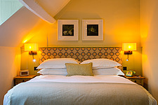 Bedroom at The Village Pub, a pub and boutique hotel in Barnsley, Oxfordshire, UK - ARC104379