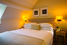 Bedroom at The Village Pub, a pub and boutique hotel in Barnsley, Oxfordshire, UK - ARC104380