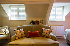 Bedroom at The Village Pub, a pub and boutique hotel in Barnsley, Oxfordshire, UK - ARC104383
