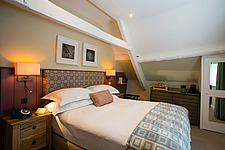 Bedroom at The Village Pub, a pub and boutique hotel in Barnsley, Oxfordshire, UK - ARC104385