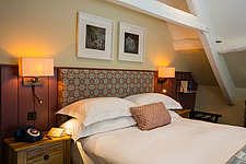 Bedroom at The Village Pub, a pub and boutique hotel in Barnsley, Oxfordshire, UK - ARC104386