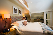 Bedroom at The Village Pub, a pub and boutique hotel in Barnsley, Oxfordshire, UK - ARC104388