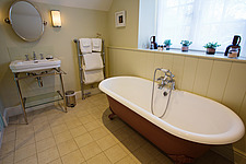 Bathroom in hotel room at The Village Pub, a pub and boutique hotel in Barnsley, Oxfordshire, UK - ARC104389