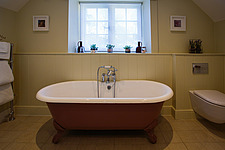 Bathroom in hotel room at The Village Pub, a pub and boutique hotel in Barnsley, Oxfordshire, UK - ARC104391