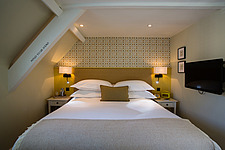 Bedroom at The Village Pub, a pub and boutique hotel in Barnsley, Oxfordshire, UK - ARC104392