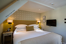 Bedroom at The Village Pub, a pub and boutique hotel in Barnsley, Oxfordshire, UK - ARC104393
