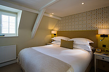 Bedroom at The Village Pub, a pub and boutique hotel in Barnsley, Oxfordshire, UK - ARC104394