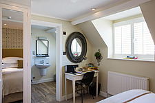 Bedroom at The Village Pub, a pub and boutique hotel in Barnsley, Oxfordshire, UK - ARC104395