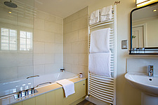Bathroom in hotel room at The Village Pub, a pub and boutique hotel in Barnsley, Oxfordshire, UK - ARC104398