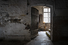 A dark door in an abandoned pottery factory in Germany - ARC104508