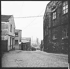 A view along Sandygate towards the town centre with the former Neptune Inn to the left foreground and Clock Tower Mill to the right foreground, Burnle... - ARC104717