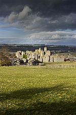 Landscape with Middleham Castle in the distance, Wensleydale, North Yorkshire, England, UK - ARC104727