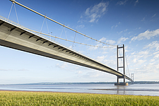 General view from the Southeast of The Humber Bridge, a suspension bridge near Kingston upon Hull, East Yorkshire, England, UK - ARC104728