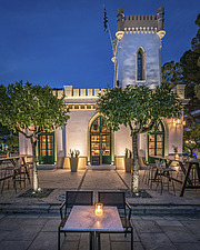 Exterior view of preserved historic landmark Pyrgos Cafe Bar in Aigio Greece renovated by architect Nikos Mourikis - ARC105026