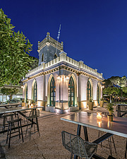 Exterior view of preserved historic landmark Pyrgos Cafe Bar in Aigio Greece renovated by architect Nikos Mourikis - ARC105028