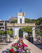 Exterior view of preserved historic landmark Pyrgos Cafe Bar in Aigio Greece renovated by architect Nikos Mourikis - ARC105042