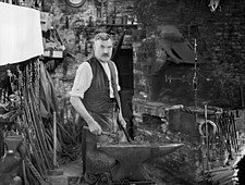 Interior view of the Forge, showing Mr Jefferies at work, Cotswolds, Gloucestershire, UK - ARC105382