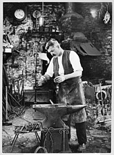 Interior view of the Forge, showing Mr Jefferies at work, Cotswolds, Gloucestershire, UK - ARC105384